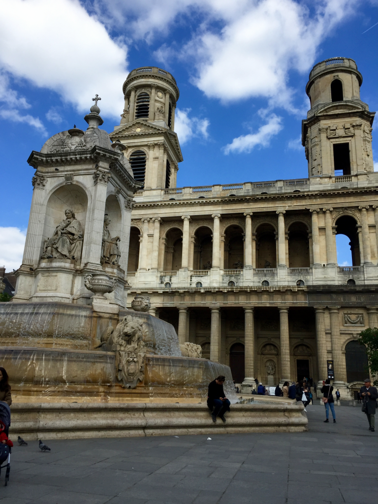 saint-sulpice facade with fountain in front